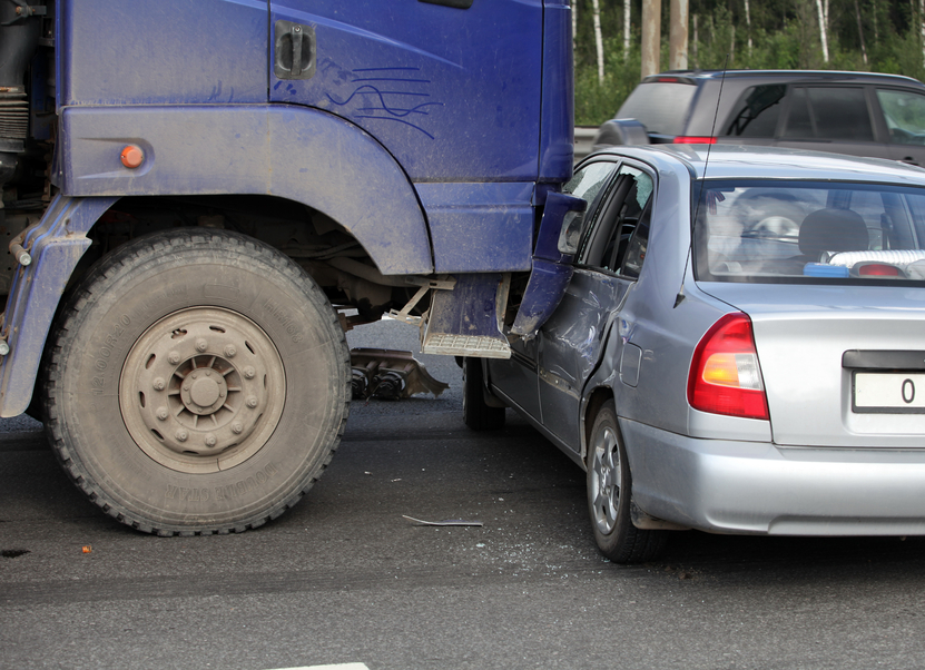 Image of a truck hitting a car.