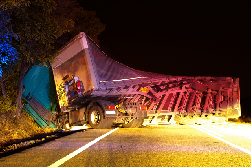 Image of a truck wreck caused by a fatigued trucker driver